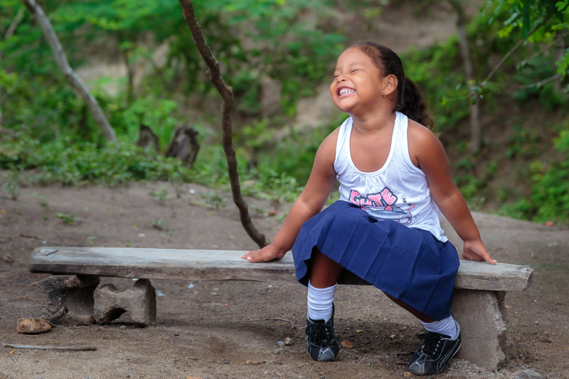 Girl in Honduras smiles