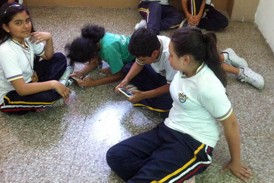 Boys and girls attending workshop at Colegio Jesus Resucitado
