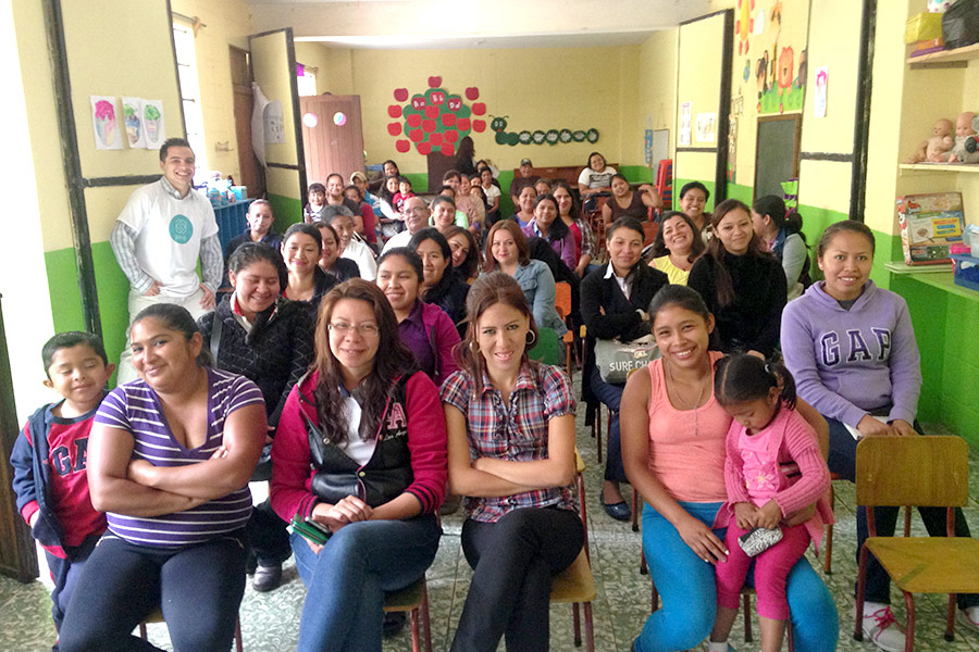 Parents attending workshop at Colegio El Universal