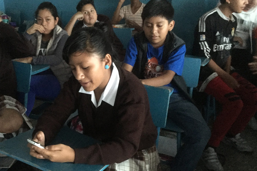Girl at Escuela Concepcion Saravia learning to use the smartphone to reach her maximum potential