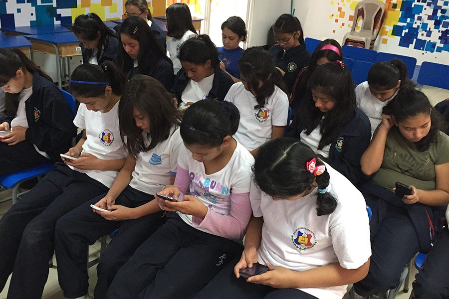 Girls learning the use of smartphones for education at Escuela República de Francia