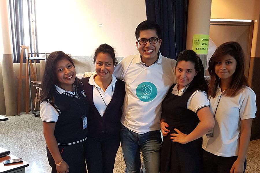 Luis with girls at Instituto Normal para Señoritas Centroamérica