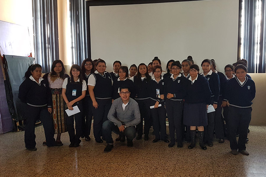 Luis Rodriguez and group of girls attending workshop at Instituto Normal para Señoritas Centroamérica