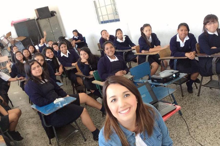 Alejandra Rojas from SHEVA with group of girls from Instituto Normal para Señoritas Centroamérica