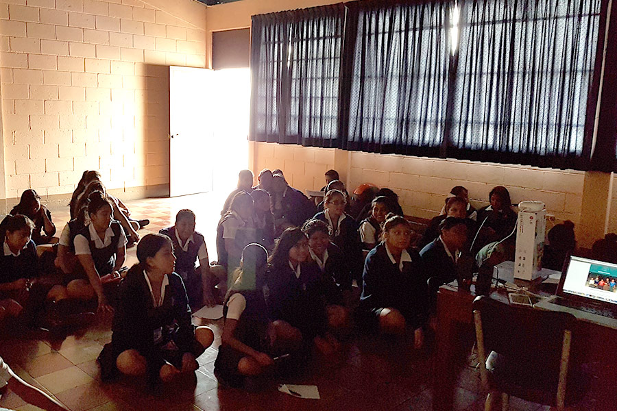 Girls learning about the uses of smartphone for education at Instituto Normal para Señoritas Centroamérica