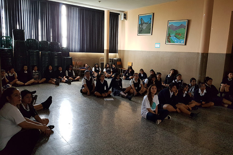 Marisabel Ruiz and Ivonne Agustin with participants of education workshop at Instituto Normal para Señoritas Centroamérica