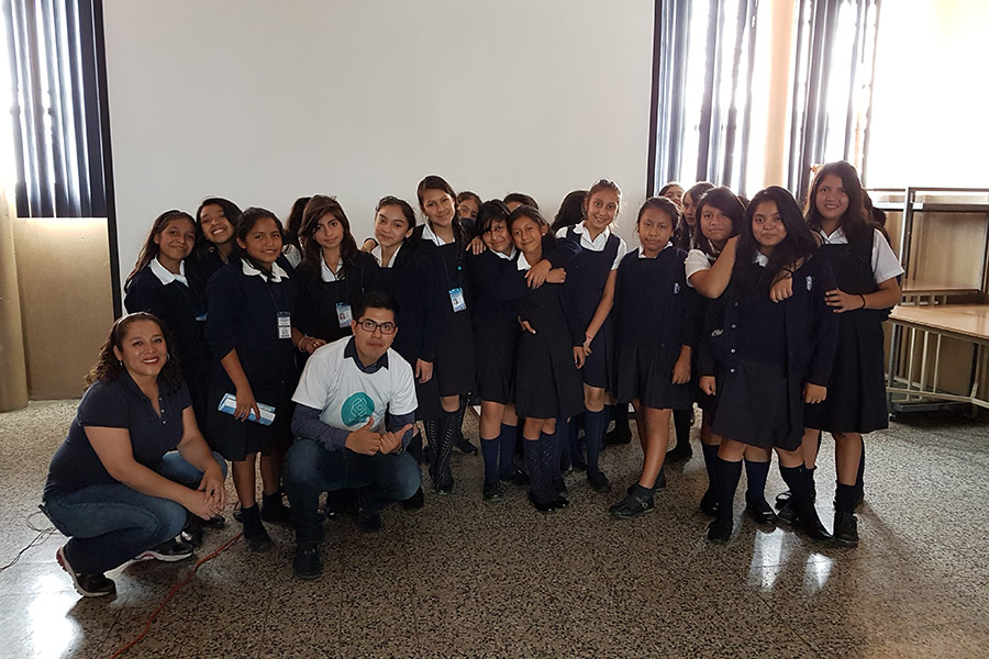 Ivonne Agustin and Luis Rodriguez from SHEVA team with girls participating in education workshop at Instituto Normal para Señoritas Centroamérica