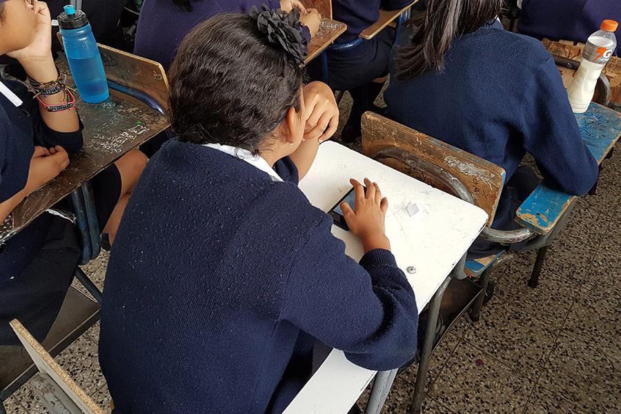 Girl with cellphone at Instituto Normal para Señoritas Centroamérica